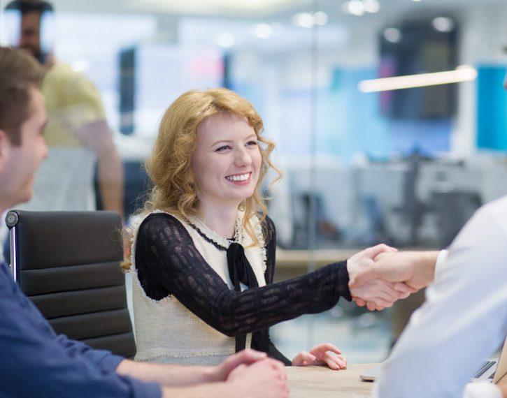 Business Partner Shake Hands on meetinig in modern office building